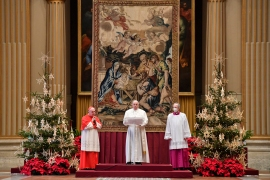Pope Francis, centre, delivers his Urbi et Orbi speech at the Vatican [Vatican Media/AFP]