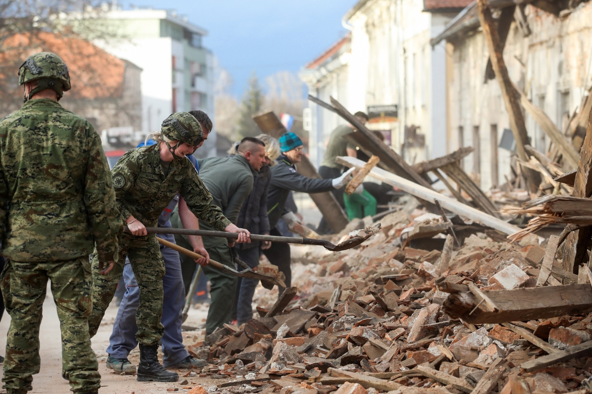 The tremor, one of the strongest to rock Croatia in recent years, collapsed rooftops in Petrinja, home to some 20,000 people, and left the streets strewn with bricks and debris. Rescue workers and the army were deployed to search for trapped residents, as a girl was reported dead. [Damir Sencar/AFP]