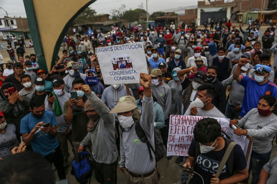 Agricultural workers in Peru say the salary and benefits provisions included in a new law do not meet their demands [Gian Mazco/AFP]