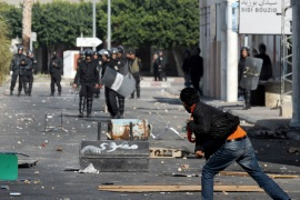 A Tunisian demonstrator throws a rock during clashes with security forces in Regueb, near Sidi Bouzid on January 10, 2011 [Fethi Belaid/AFP]