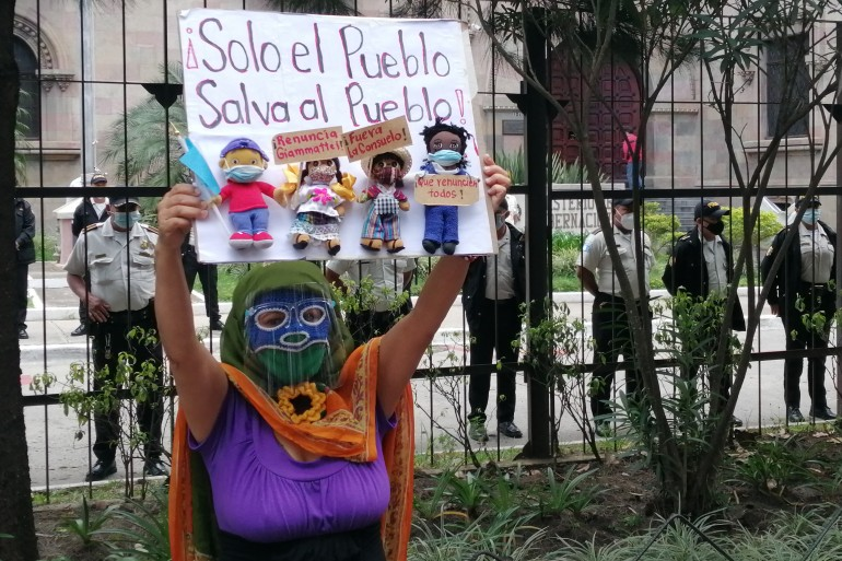Dressed in her iconic 'Virgin of the Struggle' costume, Cristina Valenzuela participates in a feminist action ahead of broader protests in Guatemala City this week [Sandra Cuffe/Al Jazeera]