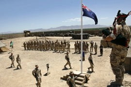 Australian and British troops stand at attention during an ANZAC day ceremony at Camp Armadillo in Afghanistan on April 25, 2008 [Reuters/Omar Sobhani]