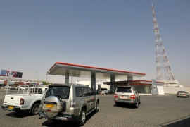 Cars line up at a petrol station in Al Buraimi near Oman's border with the UAE [File: Jumana El-Heloueh/Reuters]