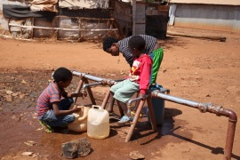 Eritrean refugee children fetch water from a tap at Mai-Aini refugee camp near the Eritrean boarder in the Tigrai region in Ethiopia [File:Tiksa Negeri/Reuters]