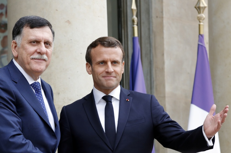 French President Emmanuel Macron meets Libyan Prime Minister Fayez al-Sarraj, who heads the UN-recognised government in Tripoli at the Elysee Palace in Paris on May 8, 2019 [File: Reuters/Philippe Wojazer]