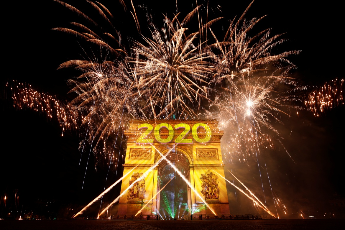 Fireworks illuminate the sky over the Arc de Triomphe during the New Year's celebrations on the Champs Elysees in Paris, France [Benoit Tessier/Reuters]