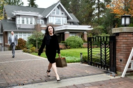 Huawei Technologies Chief Financial Officer Meng Wanzhou leaves her home to attend a court hearing in Vancouver where she is fighting extradition to the US [File: Jennifer Gauthier/Reuters]