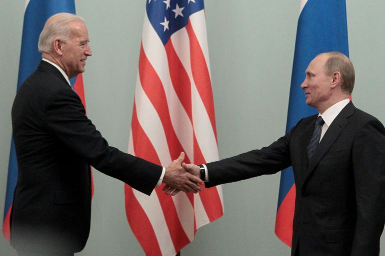 In this file photo, Russian Prime Minister Vladimir Putin, right, shakes hands with US Vice President Joe Biden, left, on March 10, 2011 in Moscow [Alexander Natruskin/Reuters]