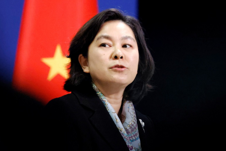 Chinese Foreign Ministry spokeswoman Hua Chunying defended her colleague over the controversial post and attacked Australia [Thomas Peter/Reuters]