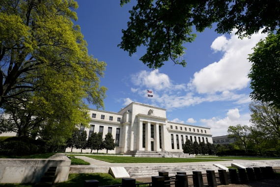 The language added at the December meeting of Federal Reserve officials was seen as a way for the US central bank to assure financial markets that there would be no quick end to the bond purchases [File:Kevin Lamarque/Reuters]