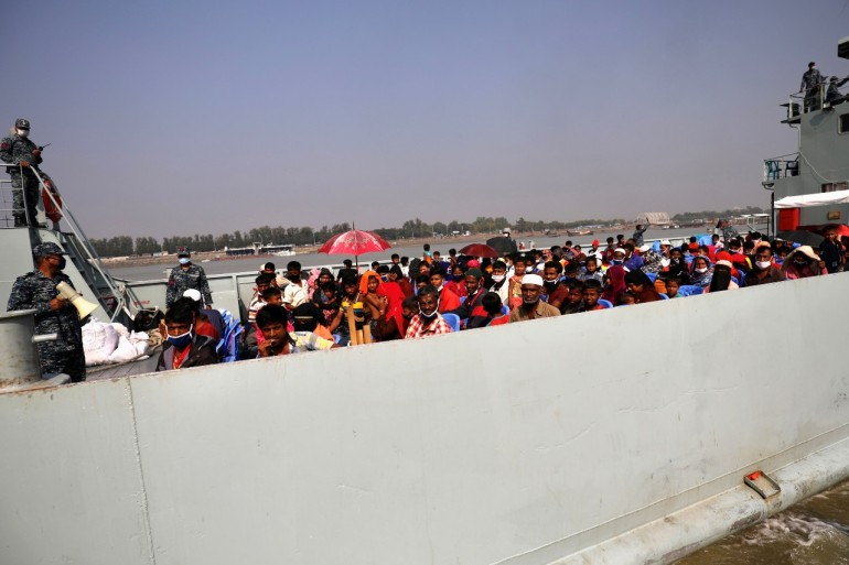 Rohingya travel by boat to Bhasan Char island on December 4 [Mohammad Ponir Hossain/Reuters]