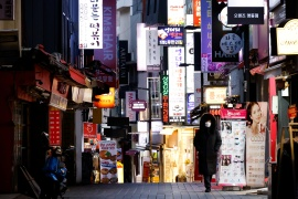 A previously crowded shopping street affected by heightened social distancing rules is pictured amid the COVID-19 pandemic in Seoul, South Korea, December 8, 2020 [Kim Hong-Ji/ Reuters]