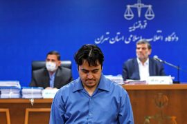 Ruhollah Zam pictured during his trial in Tehran on June 2 [File: Mizan News Agency/WANA via Reuters]