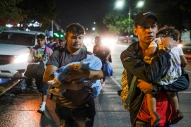 Mostly younger migrants with backpacks and some women carrying children left the northern city of San Pedro Sula on foot for the Guatemalan border after calls went out on social media to organise a caravan to the US [Jose Cabezas/Reuters]