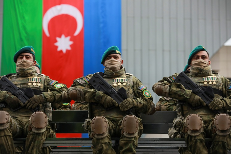 Azeri service members take part in a parade to mark victory in the Nagorno-Karabakh conflict in Baku [File: Aziz Karimov/Reuters]