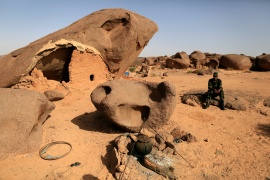 A Polisario fighter sits on a rock at a forward base on the outskirts of Tifariti, Western Sahara, September 9, 2016 [File: Zohra Bensemra/Reuters]