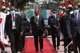 Ivory Coast President Alassane Ouattara walks after his inauguration ceremony in Abidjan [Luc Gnago/Reuters]