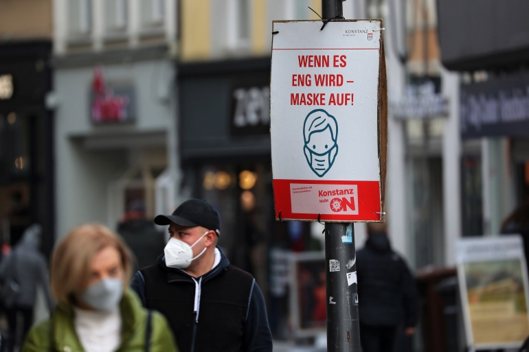A poster demands 'When it gets tight - mask on!', as the spread of the coronavirus disease continues, at a pedestrian zone in Konstanz, Germany December 15, 2020 [Arnd Wiegmann/Reuters]