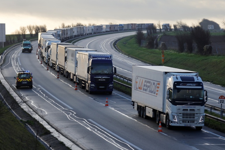 Trucks queue on the A26 highway in Nort-Leulinghem, near Calais, northern France [Pascal Rossignol/Reuters]