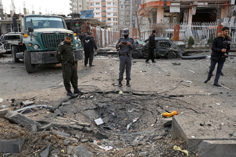 Afghan policemen inspect the site of a blast in Kabul [Mohammad Ismail/Reuters]