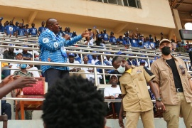 CAR's President Touadera addresses supporters at a rally as Russian mercenaries and Rwandan UN peacekeepers stand guard at a stadium in Bangui [Antonie Rolland/Reuters]