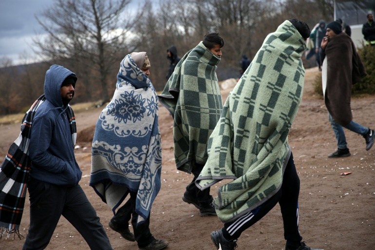 Refugees leave the burned centre 'Lipa' in Bihac, Bosnia and Herzegovina on December 24, 2020 [Dado/Ruvic/Reuters]