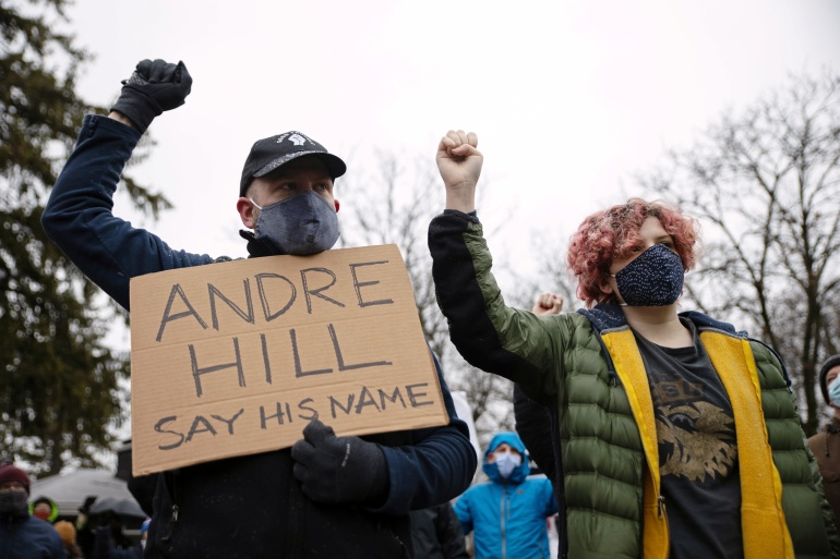 Protesters gather outside the home where Andre Hill was killed in Columbus, Ohio [Megan Jelinger/Reuters]