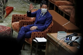 Former Japanese Prime Minister Shinzo Abe gestures while attending the lower house parliamentary session to face questioning over a possible violation of election funding laws, in Tokyo, Japan on December 25, 2020 [Issei Kato/ Reuters]