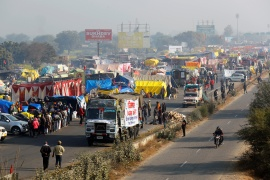 A view of a crowded highway as farmers protest against new laws at a state border in Shahjahanpur in Rajasthan state [Adnan Abidi/Reuters]