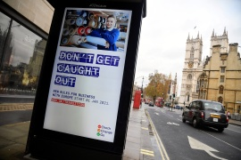An electronic billboard shows a British government information message advising business to prepare for Brexit, in London, December 4, 2020 [File: Toby Melville/Reuters]