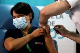 Daniela Zapata, 42, receives a dose of a COVID-19 vaccine at Dr. Pedro Fiorito hospital on the outskirts of Buenos Aires [Agustin Marcarian/Reuters]