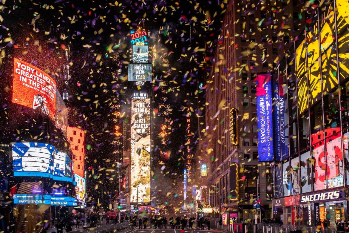 Confetti flies around the ball and countdown clock in Times Square during the virtual New Year's Eve event in Manhattan, New York City [Jeenah Moon/Reuters]