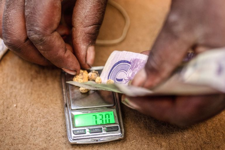 Small balls of mined Zimbabwean gold are weighed to calculate payment for artisanal miners at a small-scale mine in Zimbabwe [File: Bloomberg]