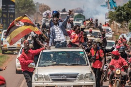 Ugandan politician Robert Kyagulanyi, also known as Bobi Wine, greets supporters near Kayunga, on December 1, 2020.(AFP/Sumy Sadurni)