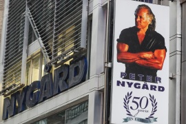 A sign bearing the likeness of Peter Nygard is displayed outside his New York offices [John Minchillo/AP Photo]