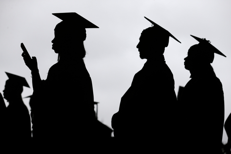 Americans owe $1.7 trillion in student loan debt, according to Federal Reserve data, and many borrowers feel the temporary freeze on federal student loan payments and interest during the COVID-19 crisis is not enough [File: Seth Wenig/AP Photo]