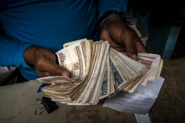 Cuba's decision to end its longtime dual currency policy is likely to be a painful transition for many Cubans, especially those forced to exchange valuable convertible pesos to less valuable Cuban pesos [File: Ramon Espinosa/AP Photo]