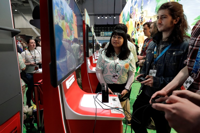 The Nintendo Switch has been the best-selling gaming console in units sold for 24 consecutive months, which is a record [File: Steven Senne/AP Photo]