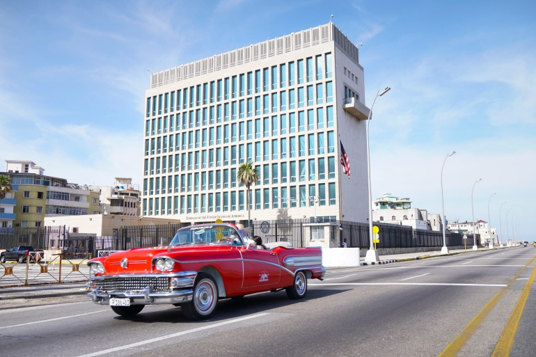 A 1950's-era Buick convertible car drives past the US Embassy in Havana, Cuba, Sunday, March, 17, 2019 [File: Pablo Martinez Monsivais/ AP]