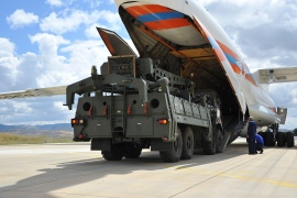 Military vehicles and equipment, parts of the S-400 air defence systems, are unloaded from a Russian transport aircraft, at Murted military airport in Ankara, Turkey [File: Turkish Defence Ministry via AP]