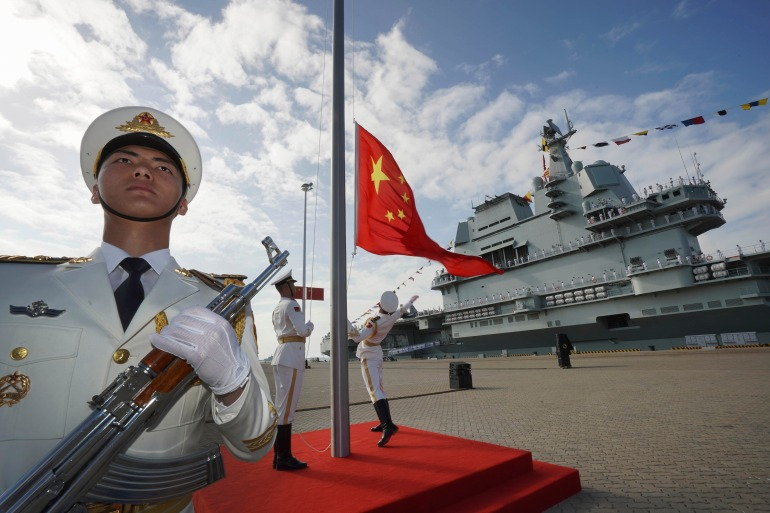 The Shandong aircraft carrier, which was commissioned a year ago, sailed through the sensitive Taiwan Strait over the weekend [File: Li Gang/Xinhua via AP Photo]