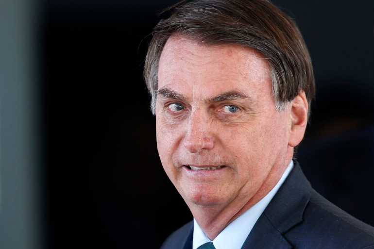 "'Prices soared after the Health Ministry expressed an interest in buying syringes,"" Bolsonaro wrote on social media [File: Eraldo Peres/AP]"