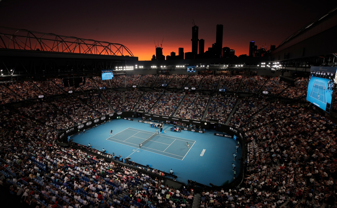 Switzerland's Roger Federer and Serbia's Novak Djokovic in the semi-final match at Rod Laver Arena as the sun sets at the Australian Open tennis championship in Melbourne, Australia in January. [Andy Wong/AP Photo]