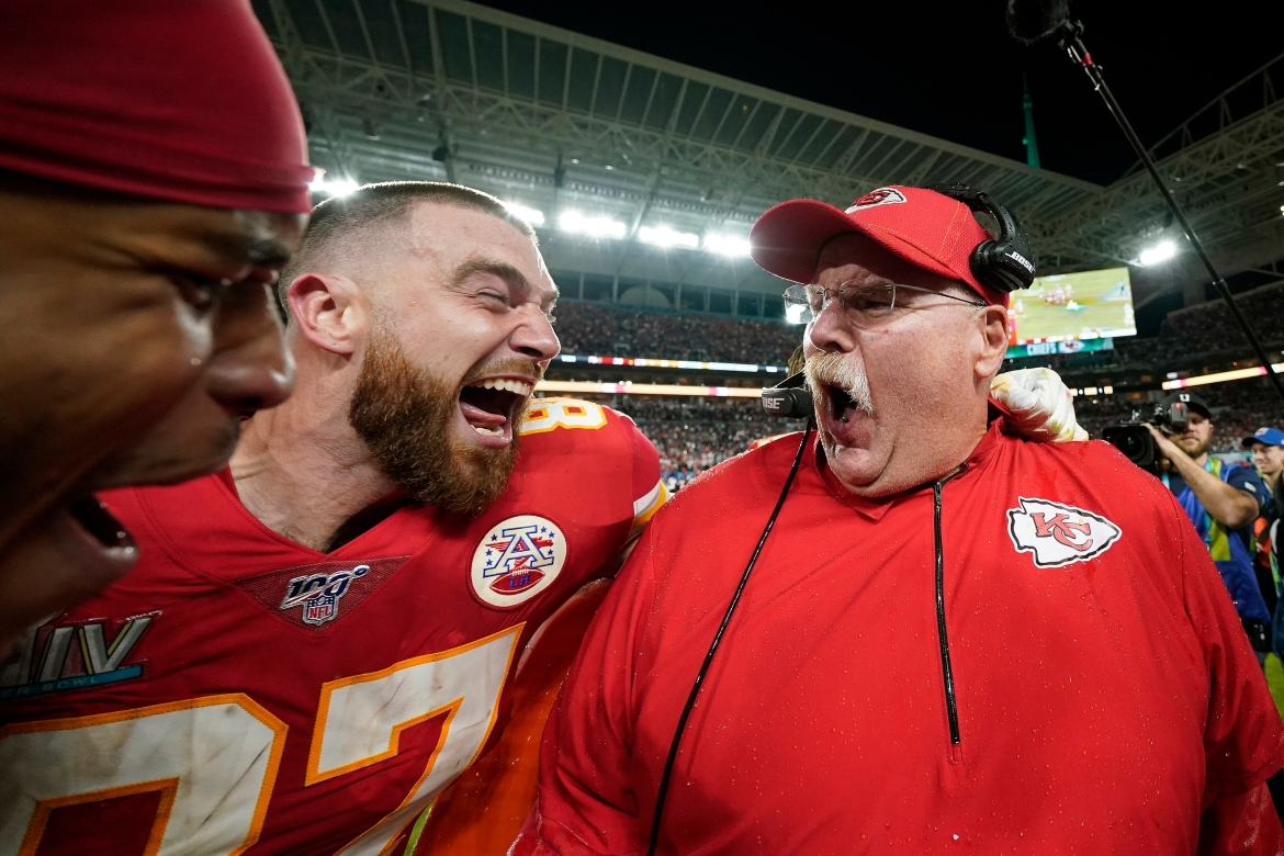 Kansas City Chiefs' Travis Kelce (L) celebrates with head coach Andy Reid after defeating the San Francisco 49ers in the NFL Super Bowl 54 football game in February 2020. [David J. Phillip/AP Photo]