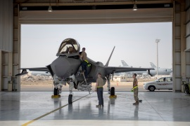 An F-35 fighter jet pilot and crew prepare for a mission at Al-Dhafra Air Base in the United Arab Emirates in this 2019 photo [Staff Sgt Chris Thornbury/US Air Force via AP]