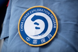 A patch for the China Lunar Exploration Program is displayed on the uniform of a worker at the Wenchang Space Launch Site in southern China's Hainan province [File: Mark Schiefelbein/AP Photo]