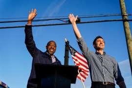 Georgia Democratic Senate candidates Raphael Warnock, left, and Jon Ossoff, right, hope for a boost from Joe Biden's campaign appearance on Tuesday [File:Brynn Anderson/AP Photo]