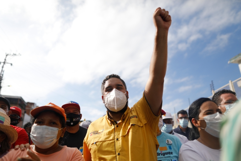 Nicolas Maduro Guerra, son of Venezuela's President Nicolas Maduro, campaigns for a spot in the National Assembly for the upcoming December 6 midterm elections, in Maiquetia, Venezuela [Ariana Cubillos/AP Photo]