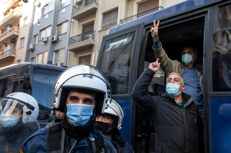 Protesters shout slogans after being detained in Athens during a rally marking the killing of Alexandros Grigoropoulos 12 years ago [Yorgos Karahalis/AP Photo]