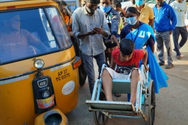 A young patient is brought in a wheelchair to the district government hospital in Eluru, Andhra Pradesh state [AP Photo]